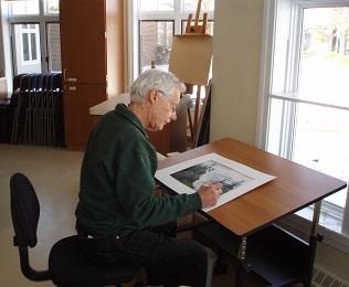 man in art studio painting