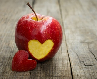 apple with a heart sliced on it