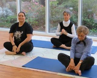 older adult women doing yoga
