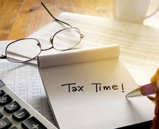 note being written saying tax time