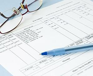 Spreadsheet with glasses and pen