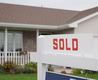 sold sign in front of home