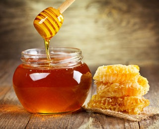 honey in a jar with honeycomb