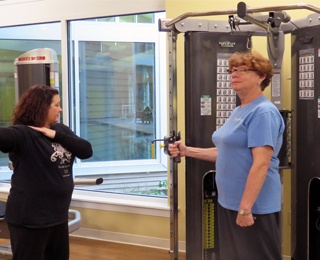 woman using a weight machine