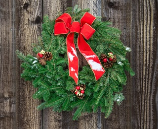 holiday wreath with red ribbon