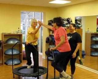 2 older adult women on exercise trampoline