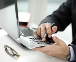 financial advisor using a calculator
