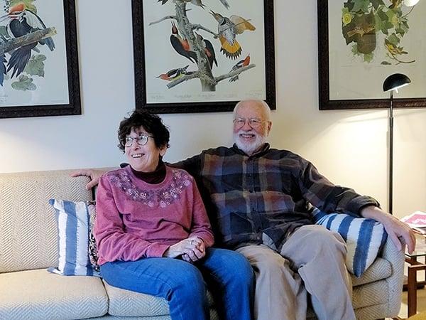 couple seated on a sofa