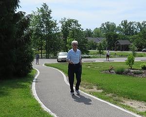 resident walking on Kendal campus