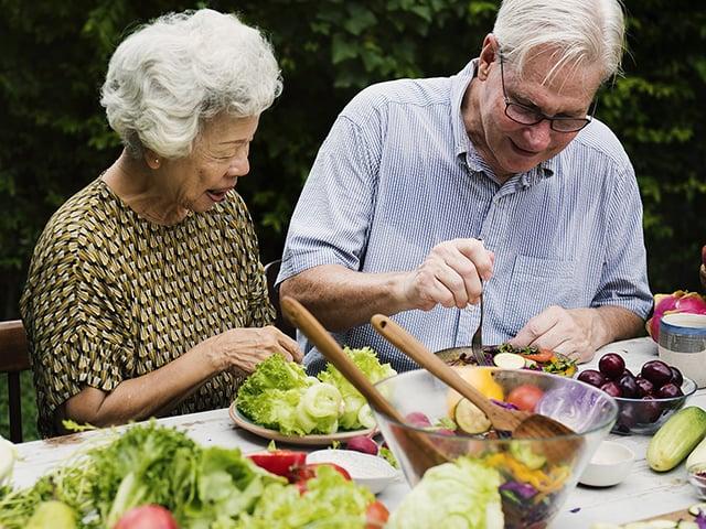 older couple eating healthy food