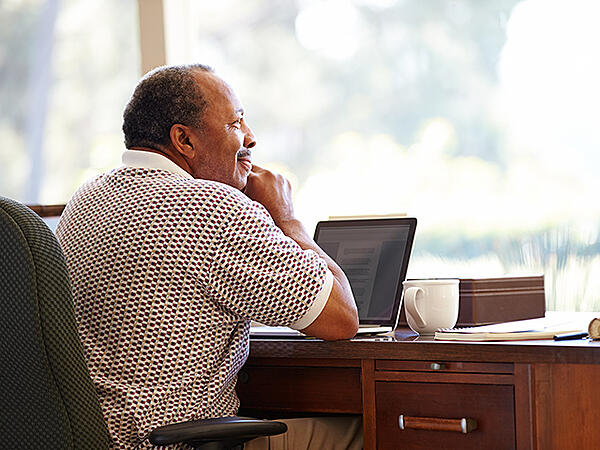 African-American older man with computer