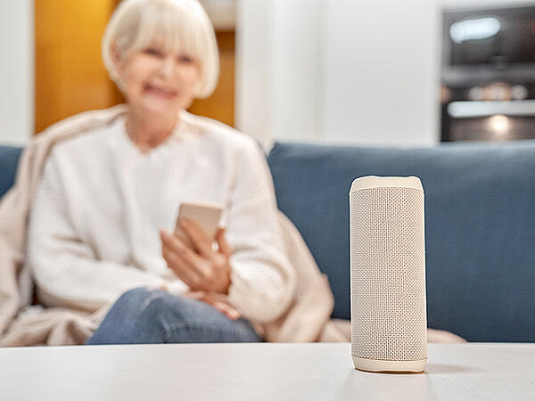 older woman with voice assistant