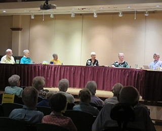 """Members of the interest group """"25 and Proud"""" holding a discussion panel at Kendal at Oberlin."""