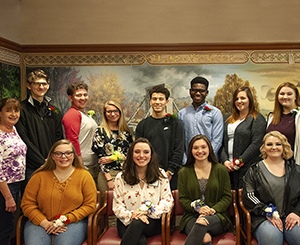 Group of students who gathered with residents of life plan community