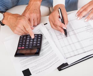 Senior calculating finances for life plan community
