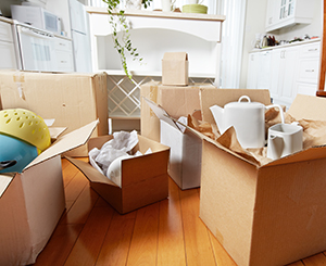 Boxes of items sitting on the kitchen floor from decluttering