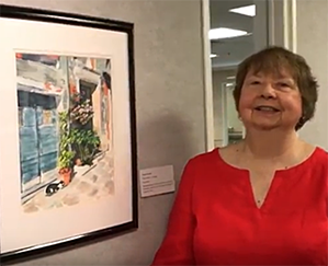Sharon Furow shows her watercolor painting at Kendal Creates.