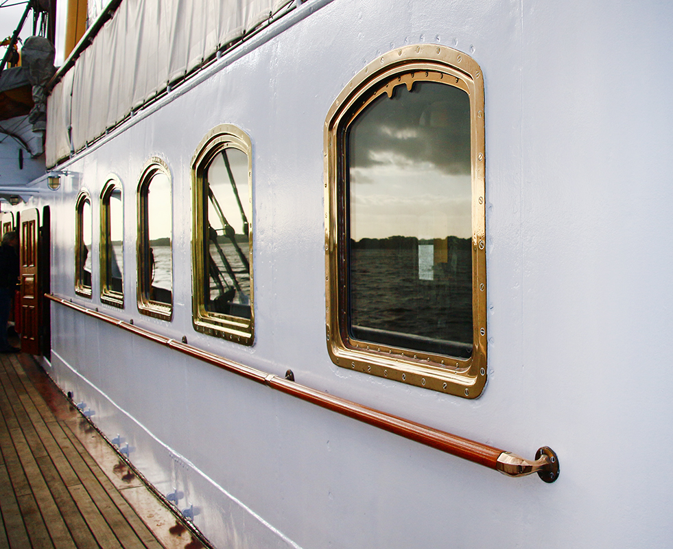 Romantic getaway on Queen Mary 2 boat showing the windows on one of the decks