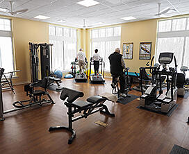 Residents using equipment at the community wellness center.