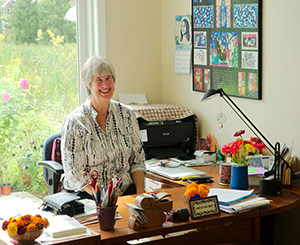Resident working at her desk in an office