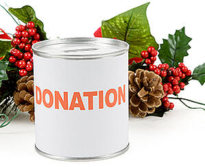 Donation can that is surrounded by festive holiday plants.