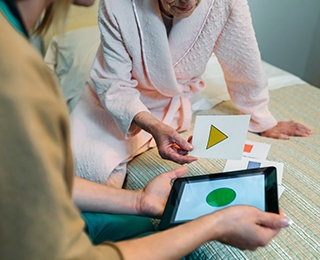 caregiver playing a brain game with older adult