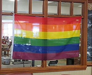 lgbt flag hanging in dining area of kendal at oberlin