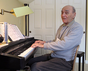 Resident Bob Randel learning to play his wife's piano