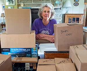 Molly with boxes gathered from downsizing home