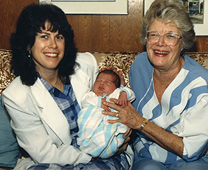 Three generations of women sitting on the couch