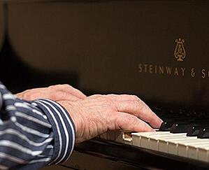 Kendal at Oberlin resident playing piano
