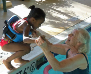 older-adult-and-child-in-pool